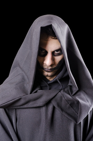malevolent: Isolated on black dark guy portrait costume