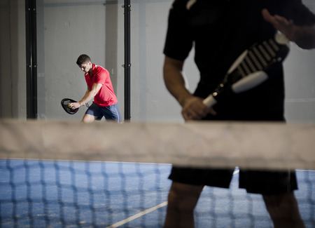 Paddle tennis couple ready for serve  photo