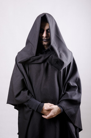 Dark guy like a sectariam with tunic costume Stock Photo