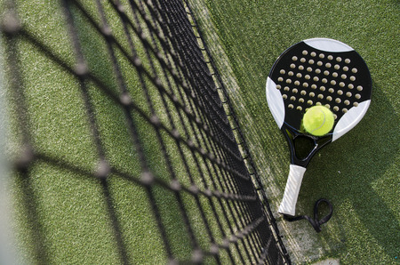 Paddle tennis objects on turf near to net Stock Photo
