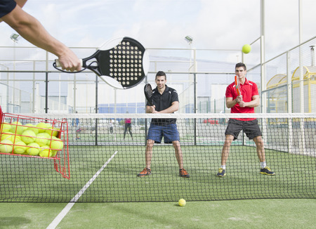 Paddle tennis master with his pupils