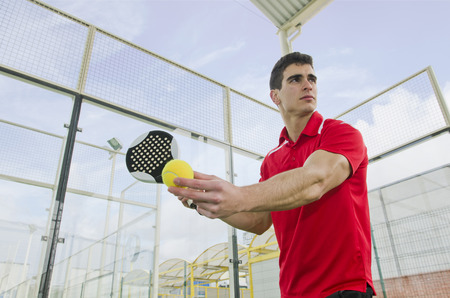 Paddle tennis master ready for serve ball