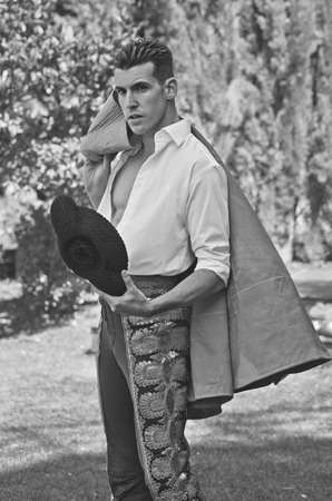 torero: Spanish model with torero performance posing in garden with black and white processing Stock Photo