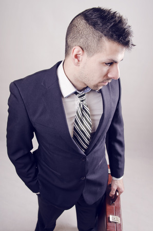 metrosexual: Young businessman with modern hairstyle posing in wide angle portrait