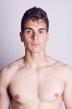 pectoral: Young latin fit man portrait with serious expression  Blue levels procesing  Stock Photo