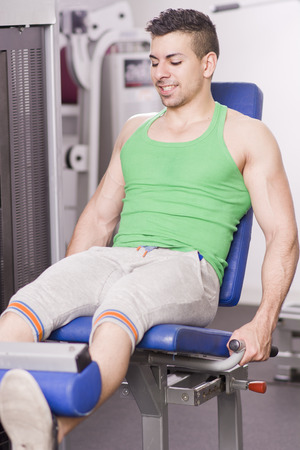 femoral: tan young man exercising femoral muscle Stock Photo