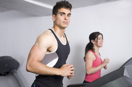 young people in gym Running on the treadmill Stock Photo - 27772333