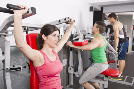 People posing in gym room ready for fitness exercises photo