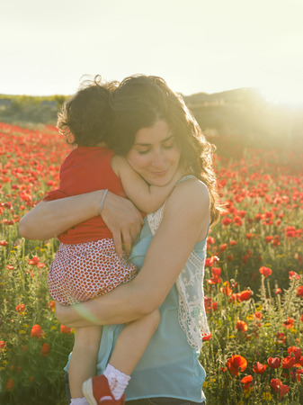 Mom hug with backlight in outdoors  garden photo