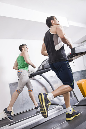 machine man: Gym people running on treadmill indoor in fitness club