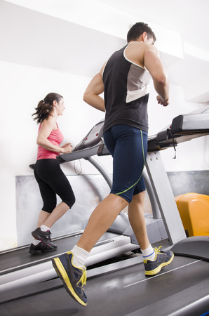 People doing running exercise with the treadmill photo