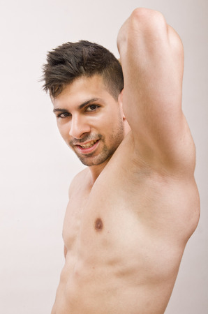 axilla: Fitness guy posing  showing  shaved armpit