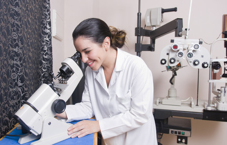 oculist: Optometrist chair, ophthalmology diopters calibration in oculist lab of young woman doctor.