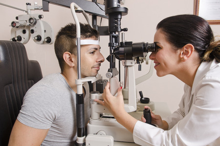 eye exam: Woman in optical dark lab doing eyes exam for glasses graduation