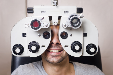 Young boy in an optical scans machine exams his vision and optometry photo