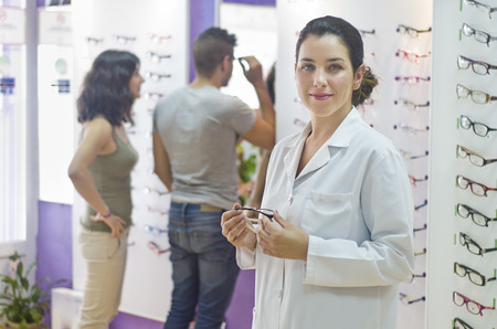 Optometry  Optical woman posing in glasses store photo