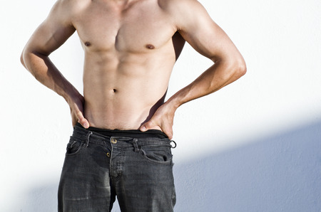 abdominal wall: Sexy torso of young adult man wit natural sunset light