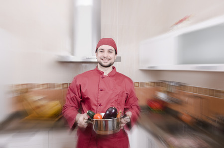 kitchen spanish: Chef and raw vegetables with zoom effect in kitchen