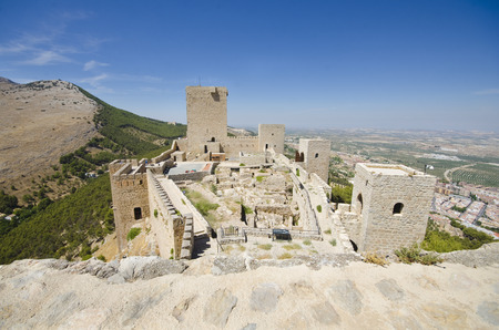 catalina: Wide agle mage of jaen castle in sunny summer day with mountains and city in the background