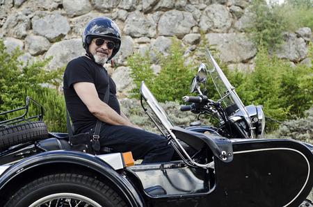 Senior man on custom in outdoors image. photo