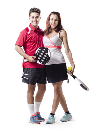 Woman and man posing isolated on white backgrund with paddle tennis sportswear, racket and ball. photo