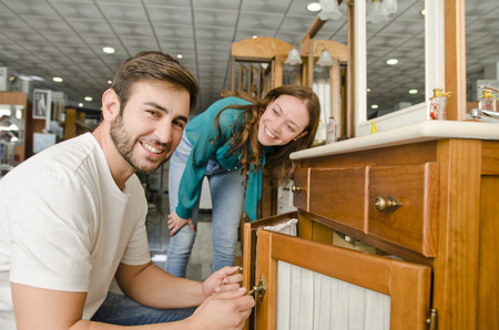 retail business: Couple buying furniture at big plumbing store