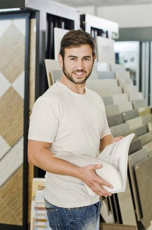 plumbing accessories: Plumbing, tile, ceramic  and furniture store clerk or client posing and smiling looking at the view