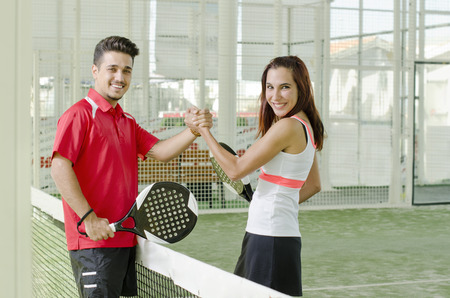 Man and woman are a paddle tennis team in mixed tournament photo