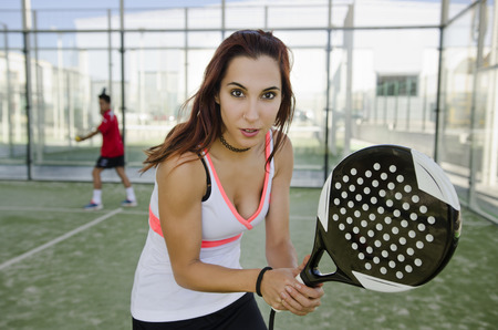Woman ready for play paddle tennis in outdoors court photo