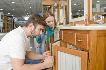 Couple looking sink in furniture shop for home removals