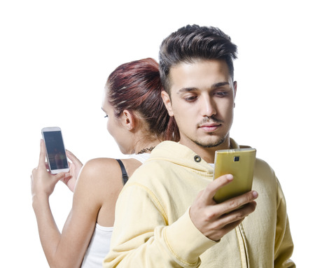 omission: Young couple with smart  phone addiction isolated on white