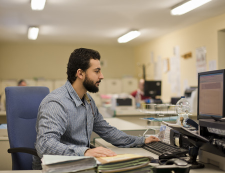 file clerks: Image of  bearded office clerk working at office