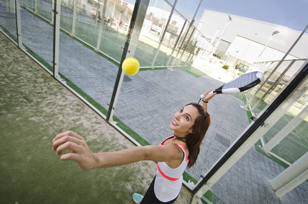 Paddle tennis shot wide angle woman image in court
