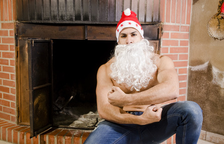 Fitness santa in chimney posing strong for health happy new year photo