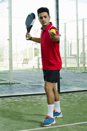 serve: Young full man ready for paddle tennis serve