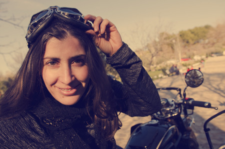 sidecar: Woman biker looking at the view with glasses and vintage filter