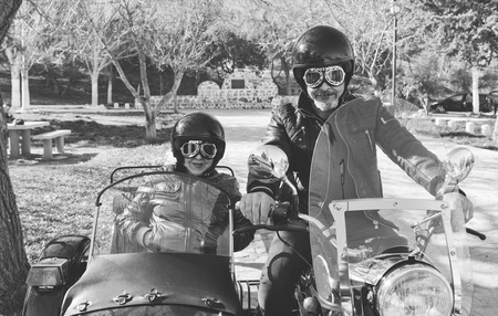 Senior couple on sidecar bike with monochrome effect photo