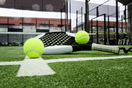 Paddle tennis objects on grass background Imagens