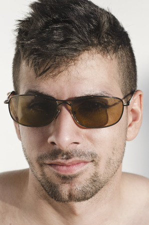 metrosexual: Closeup portrait of man with sunglasses in outdoors