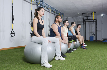 group of people ready for balloon exercises at crossfit room photo