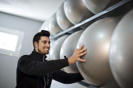 rom: Monitor fitness trainer in balloon rom preparing training