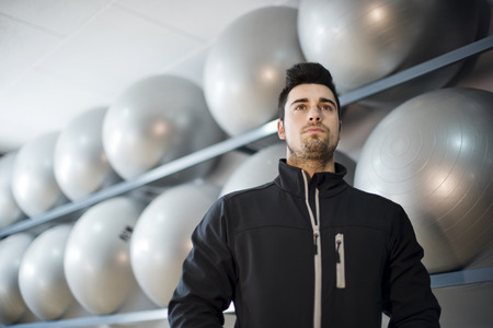tracksuit: Monitor fitness trainer in balloon room preparing training