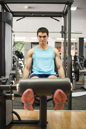 femoral: Legs femoral and quadriceps muscle training at pull in gym Stock Photo