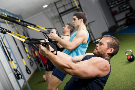 Real people training crossfit at gym center photo