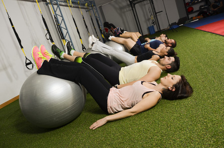 Group of young people training with balloon abdominal muscle photo