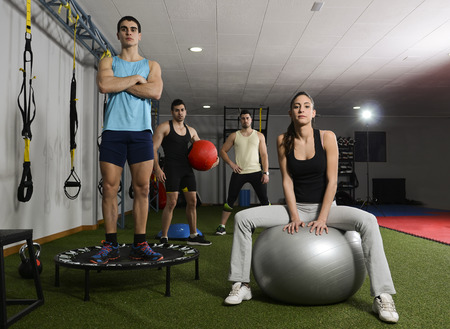 Young people at gym posing ready for exercises at cross and fit room photo