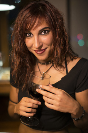 ambient light: Woman drinking wine in restaurant with ambient light Stock Photo