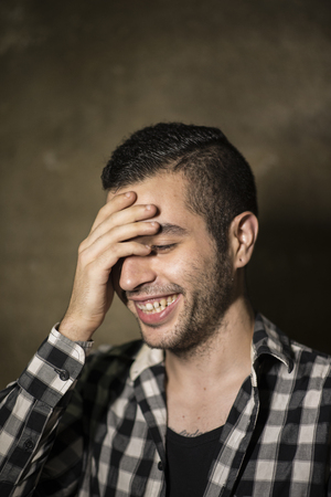 plaid shirt: Man with cool plaid shirt posing in studio shot Stock Photo