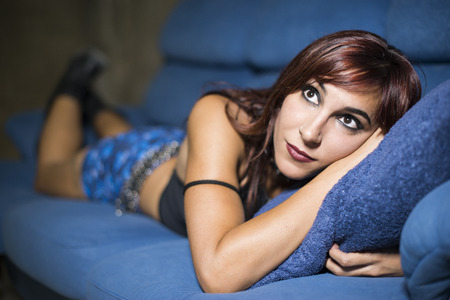 gothic woman: Sexy 20s gothic woman relaxing in sofa Stock Photo