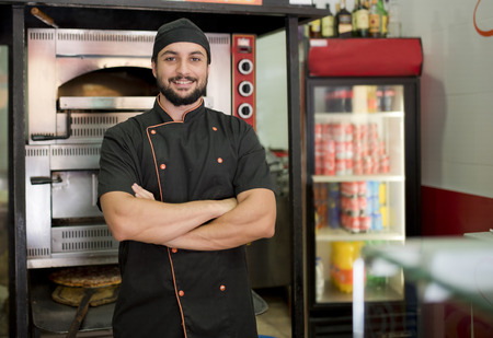 turkish man: Turkish man posing near to oven